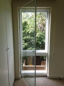 Hinged frame double glazed window over existing window